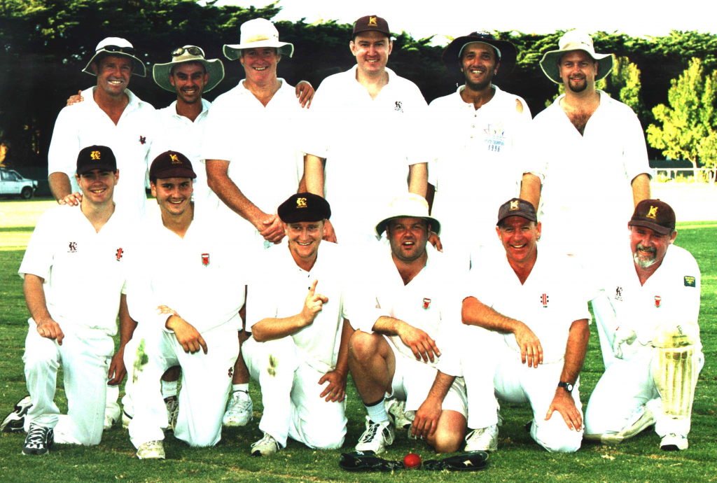 Photo of Keswick Cricket Club premiers 1999-00. Group of players with premiership cup.