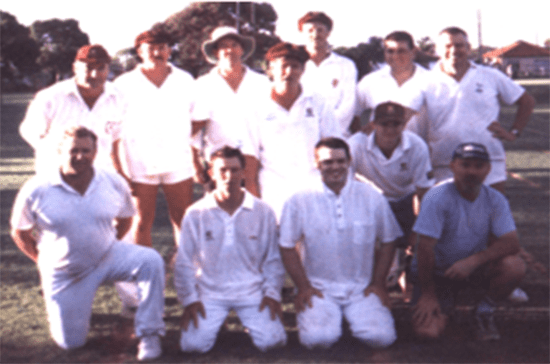 Photo of Keswick Cricket Club premiers 1999-00. Group of D-grade players with premiership cup.