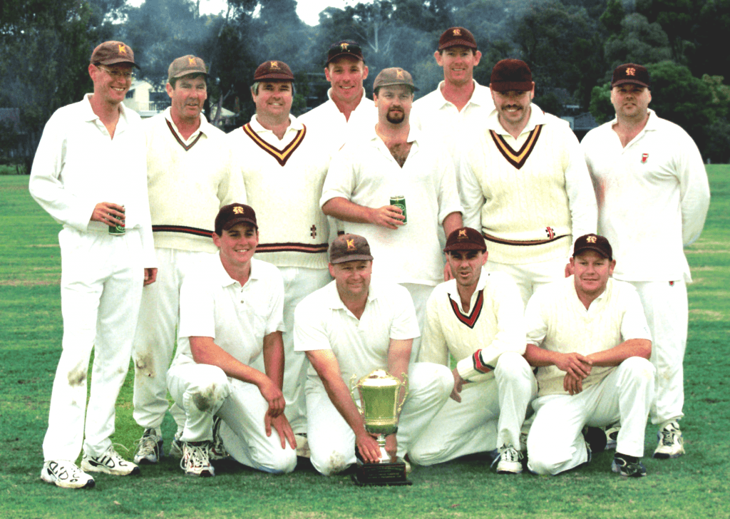 Photo of Keswick Cricket Club premiers 2000-01. Group of players with premiership cup.