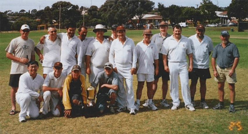 Photo of Keswick Cricket Club premiers 2001-02. Group of players with premiership cup.