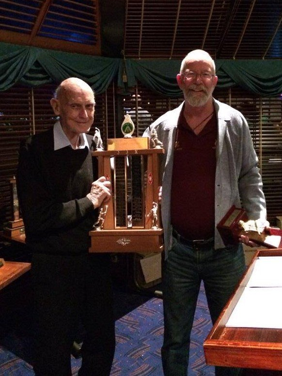Barry Kearsley accepting his 4th JJ Hep Trophy from Joe Heptinstall at the 2014 Keswick Cricket Club AGM